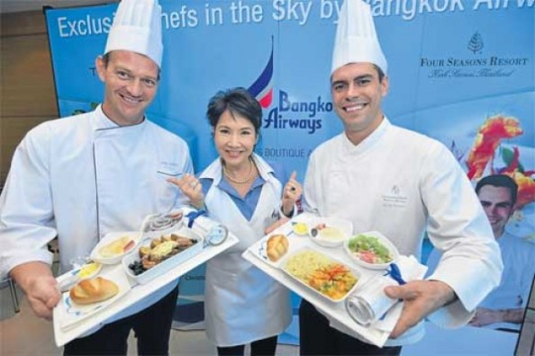 Showing off some of the special dishes at BAC's catering facilities at Suvarnabhumi airport are Christopher Patzold (left), executive chef at the Chedi Chiang Mai; M.L. Nandhika Varavarn (centre), a Bangkok Airways vice-president; and Alex Gares, executive chef at the Four Seasons Resort Koh Samui.